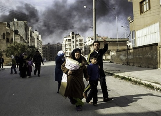 A family escapes from fierce fighting between Free Syrian Army fighters and government troops in Idlib, north Syria, Saturday, March 10, 2012 (by FreedomHouse from Flickr under Attribution 2.0 Generic CC BY 2.0 license).