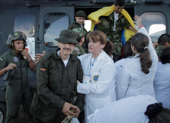 Jorge Romero, one of the 10 members of the security forces just released by the FARC-EP, walks away from the Brazilian army helicopter that flew him to freedom on Monday, 2 April 2012. © ICRC / B. Heger