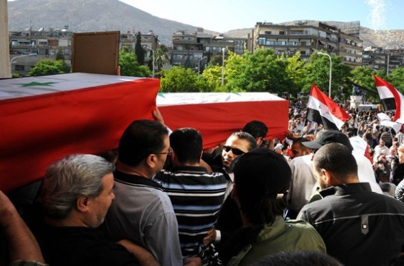 Burying victims of those killed in Damascus car bombings. Photo: Sana