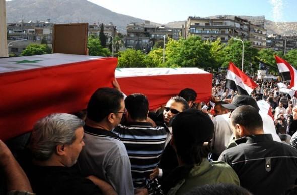 Burying victims of those killed in Damascus car bombings. Photo: Sana