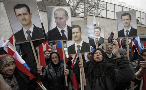 Syrians hold photos of Bashar Assad and Vladimir Putin during a pro-government demonstration in front of the Russian embassy in Damascus, Syria, Sunday, March 4, 2012. (Photo: Freedom House)