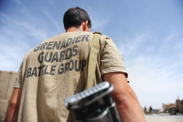 A soldier of the 1st Battalion Grenadier Guards is pictured between operations at the main operating base at Lashkar Gah, Afghanistan. (Photo by Cpl Paul Morrison RLC © UK MOD/Crown Copyright 2012).