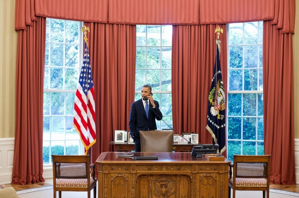 President Barack Obama talks on the phone with the US Solicitor-General after health care ruling Official White House phote Pete Souza