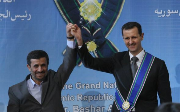 Iranian President Mahmoud Ahmadinejad granting the Grand National Order of the Islamic Republic of Iran to Bashar al-Assad in October 2010.