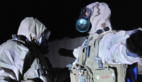 US military personnel train in CW suits. Photo  DoD/Benjamin Kittleson