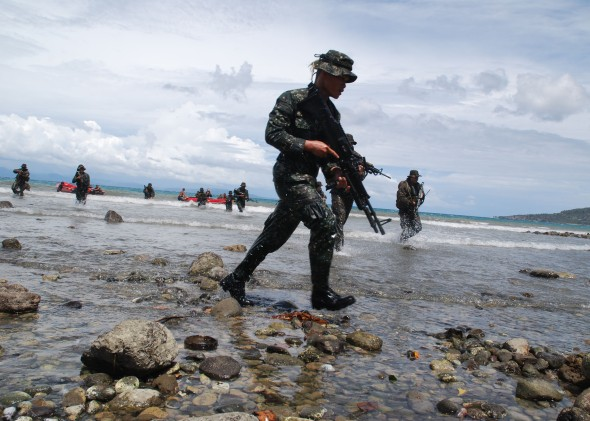 U.S. Marines and Philippine Marines advance to the beach during an amphibious beach assault exercise for Cooperation Afloat Readiness and Training (CARAT) Philippines 2012. CARAT is a series of bilateral military exercises between the U.S. Navy and the armed forces of Bangladesh, Brunei, Cambodia, Indonesia, Malaysia, the Philippines, Singapore, and Thailand. (U.S. Navy photo by Chief Mass Communication Specialist Aaron Glover/Released)
