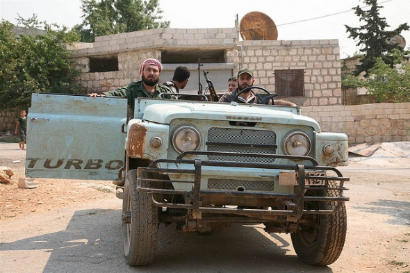 Rebels use an old Nissan jeep in their fight against Syrian security forces