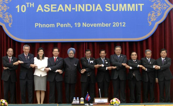 Phnom Penh: Prime Minister Manmohan Singh with others Head of States  pose a group photo during a 10th ASEAN-India Summit  at Peace Place in Phnom Penh, Cambodia on Monday. PTI Photo by Kamal Singh