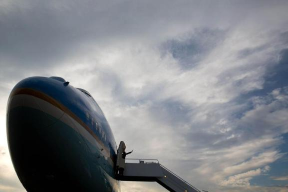 President Obama waves as he boards Air Force One.