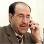 Nuri al-Maliki on his cellphone. Photo Kurd Net